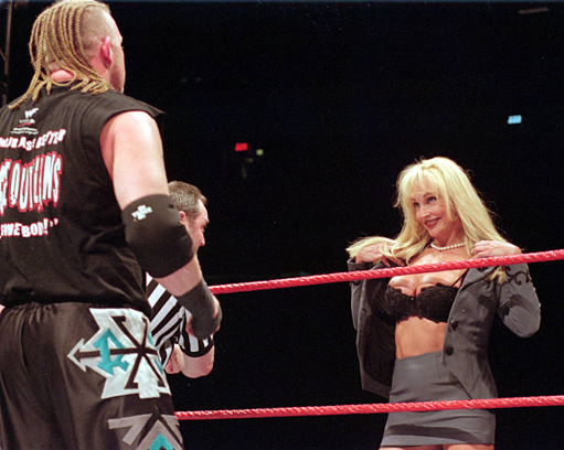 Debra distracts The Road Dogg