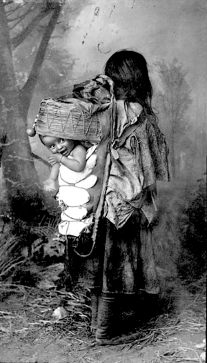 Mescalero Apache woman carrying an infant in a wiege board (Frank A. Randall 1880s)