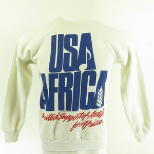 A Vintage USA For Africa sweatshirt کے, سویاٹشارٹ
