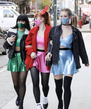 Madelaine Petsch, Camila Mendes and Lili Reinhart, walking together in Vancouver on 31.10.2020.