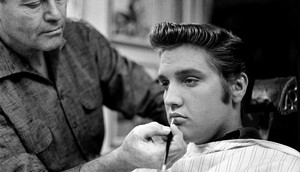 Elvis Getting his makeup done